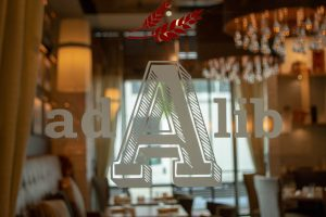A view through the glass door into Ad Lib's private event dining room.